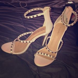 White heals with beads on bands